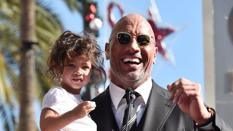 HOLLYWOOD, CA - DECEMBER 13: Actor Dwayne Johnson (R) and Jasmine Johnson attend a ceremony honoring Dwayne Johnson with the 2,624th star on the Hollywood Walk of Fame on December 13, 2017 in Hollywood, California. (Photo by Alberto E. Rodriguez/Getty Images)