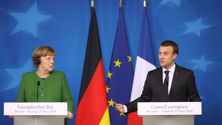 French president Emmanuel Macron speaks during a joint press conference with Germany's Chancellor Angela Merkel (L) on the second day of a summit of European Union (EU) leaders on March 23 2018, in Brussels.