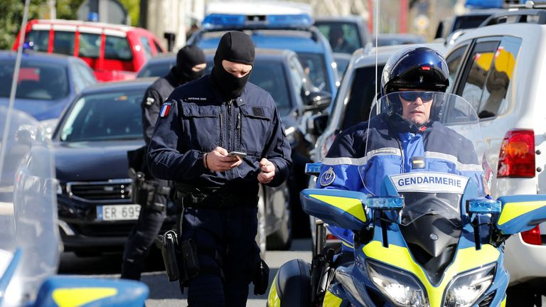 French supermarket siege: 'Hero' police officer fighting for