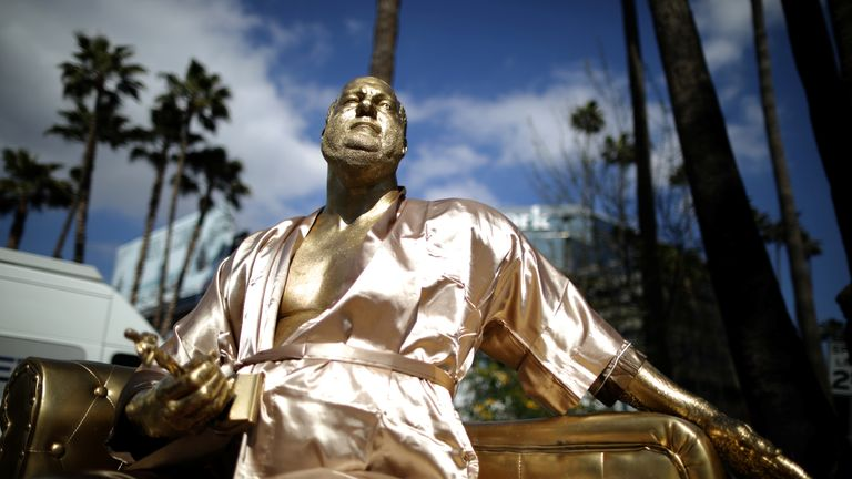 A golden statue of disgraced mogul Harvey Weinstein sitting on a casting couch in Hollywood boulevard