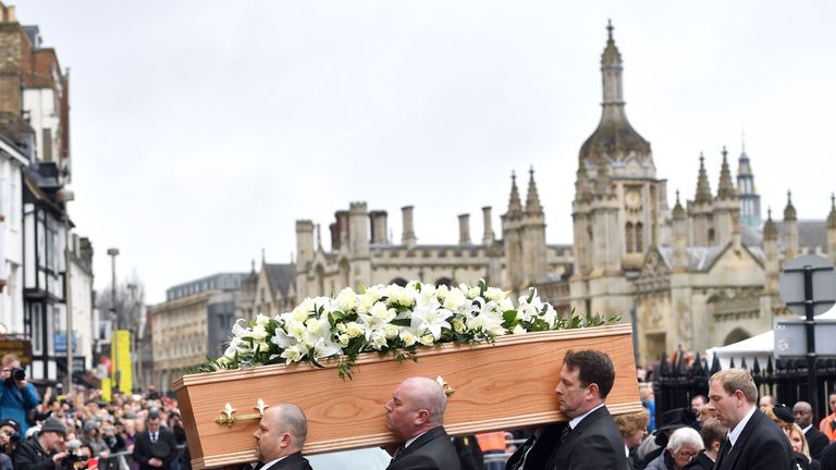 The casket containing Professor Stephen Hawking is carried into the church