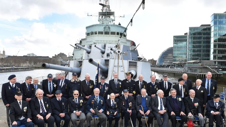 Veterans who served on HMS Belfast in the 1940s, 1950s and 1960s meet aboard the historic warship on the River Thames to mark its 80th anniversary.