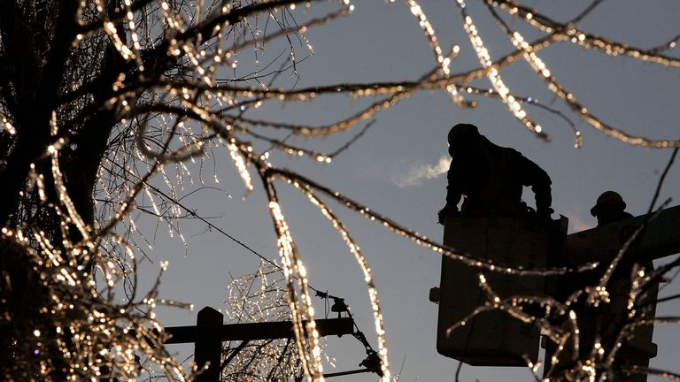 DUNKIRK, MD - FEBRUARY 15:  Trees are covered with ice as linemen working for the Southern Maryland Electric Company repair damaged power lines February 15, 2007 in Dunkirk, Maryland. Southern Maryland was hit with freezing rain storm on Tuesday causing many housholds to lose power.  (Photo by Mark Wilson/Getty Images)