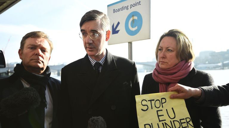 Jacob Rees-Mogg gives a press conference on the Thames as dead fish are thrown in