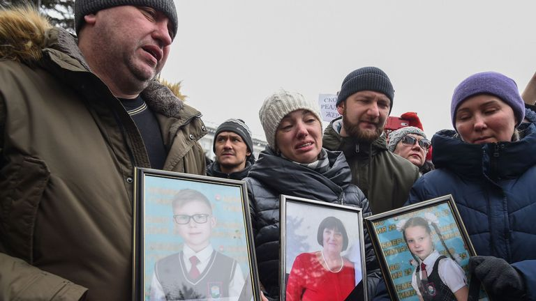 People gather to pay tribute to the victims of the fire