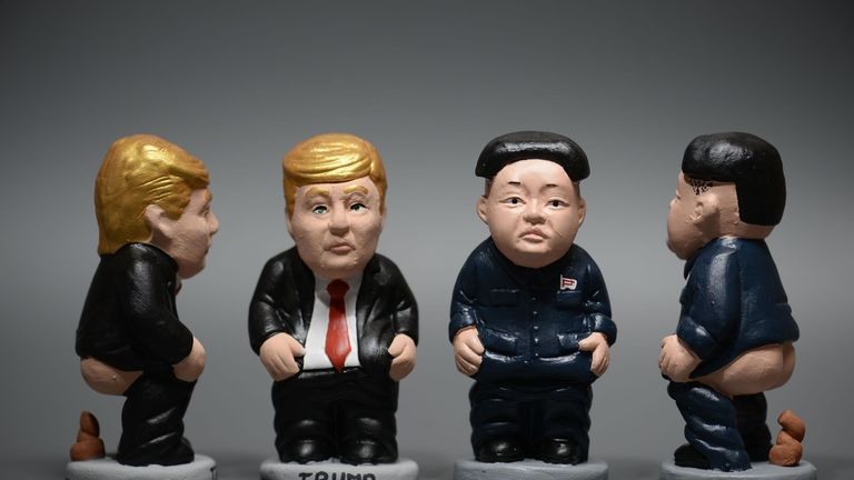 Ceramic figurines, called 'caganers' (poopie), representing North Korean leader Kim Jong-Un (R) and US President Donald Trump (L) are displayed at a factory in Torroella de Montgri on November 7, 2017