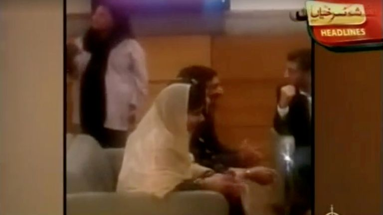 Malala Yousafzai sits with her family in a VIP lounge of Islamabad Airport