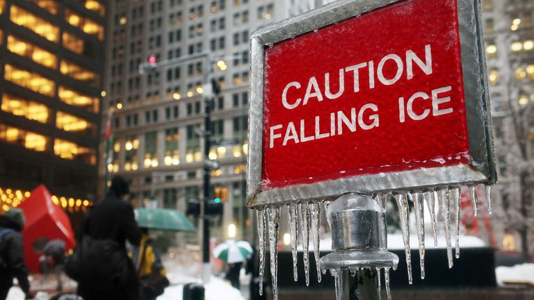 NEW YORK, NY - FEBRUARY 02:  A sign warns people of ice during the morning commute along in lower Manhattan on February 2, 2011 in New York City. The icy weather is part of a massive winter storm that stretches from New Mexico to Maine and has brought freezing rain and blizzard conditions to more than 30 states.  (Photo by Spencer Platt/Getty Images)