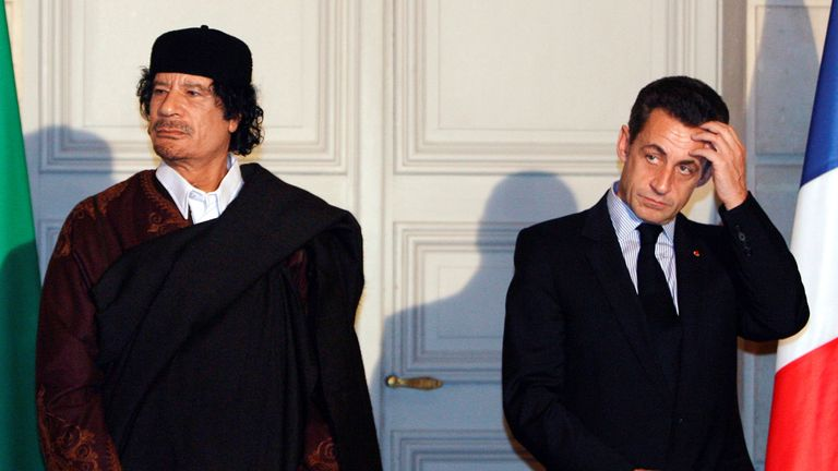 Nicolas Sarkozy and Muammar Gaddafi attend a ceremony for the signature of 10 billion euros of trade contracts between the two countries at the Elysee Palace in Paris, 2007