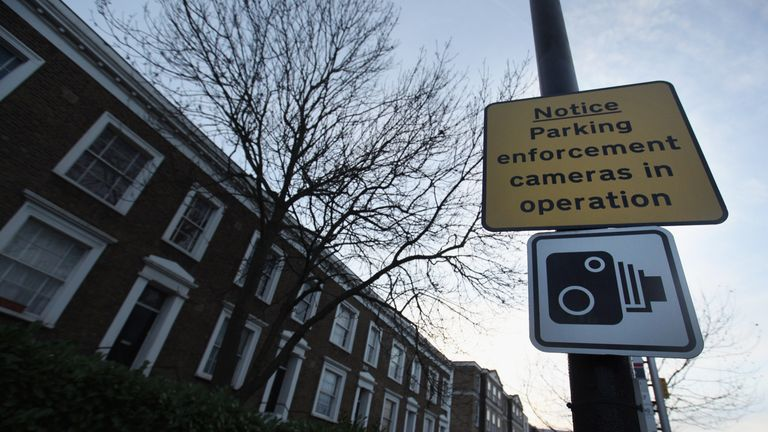 LONDON, ENGLAND - FEBRUARY 07: A parking information sign on a stretch of Clapham Park Road in the South London borough of Lambeth which last year issued over 2,500 GBP per day in fines from traffic and parking violations on February 7, 2011 in London, England. Civil enforcement officers and two CCTV bus lanes cameras generated 914,040 GBP from 16,800 tickets issued on the 500 yard residential road in 2010. (Photo by Oli Scarff/Getty Images)