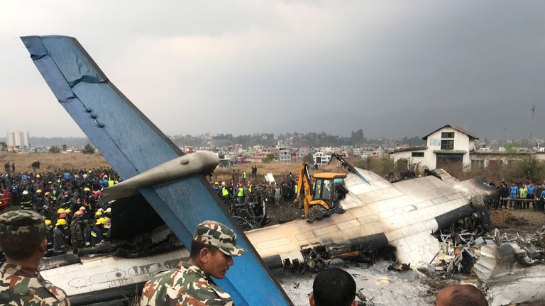 Wreckage of an airplane is pictured as rescue workers operate at Kathmandu airport, Nepal