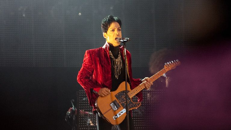 Prince performs on stage