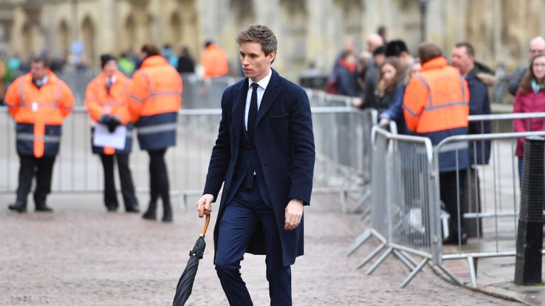 Actor Eddie Redmayne arrives at the service