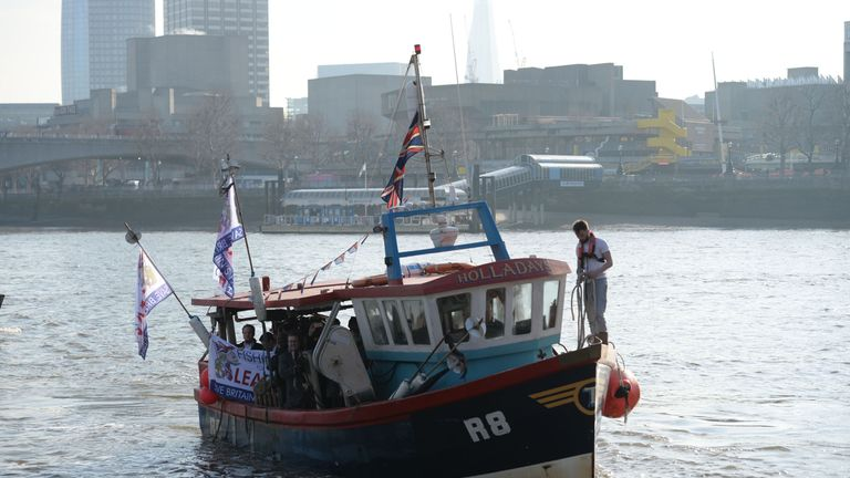 The Fishing for Leave boat on the Thames in London, before they plan to dump fish in the river opposite the Houses of Parliament in a symbolic demonstration against the Government's Brexit transition deal.