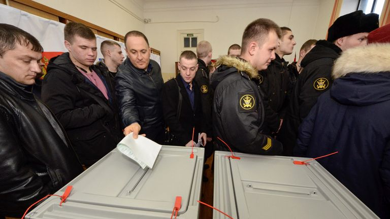 People queue to vote during the presidential election in the eastern city of Vladivostok