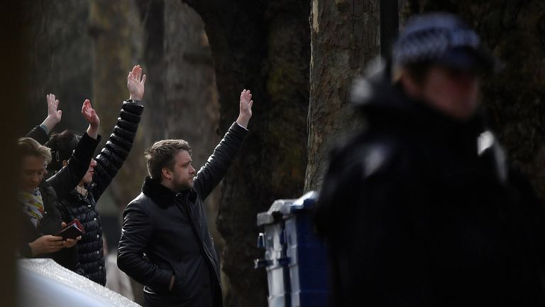 Embassy staff wave as colleagues and children board buses outside Russia's Embassy in London