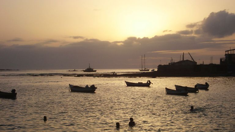 Children play in the water at sunset in the port of Sal Rei, the main town of Cape Verde's Boa Vista island, July 15, 2010