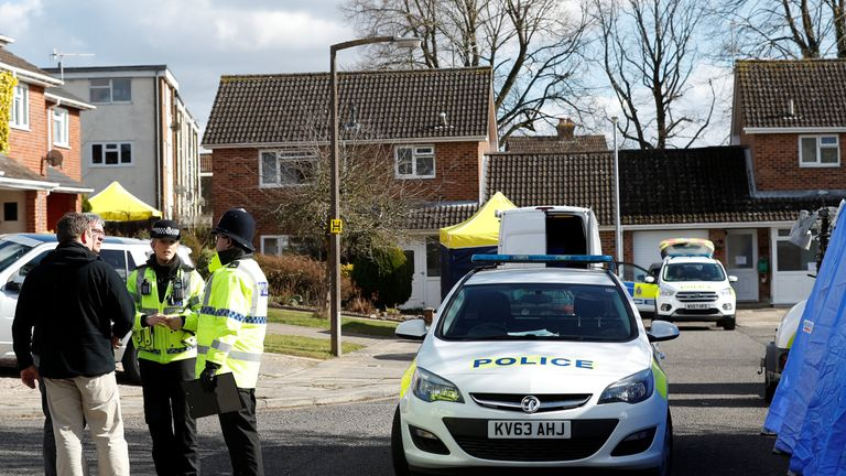 Police officers stand guard outside the home of Sergei Skripal in Salisbury