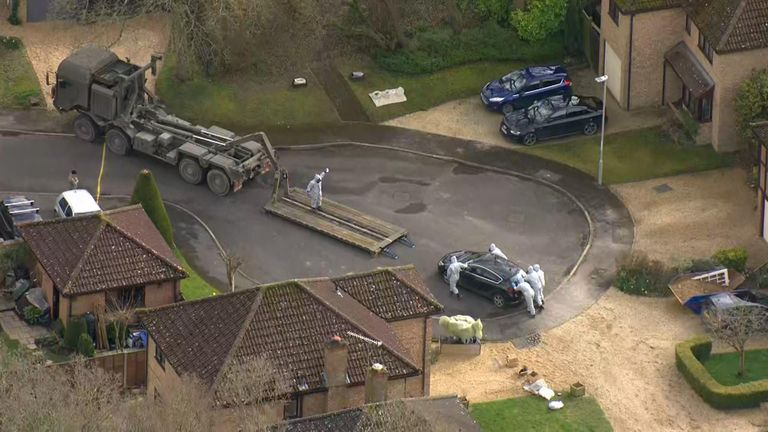 An army vehicle removes a car from the home of detective sergeant Nick Bailey
