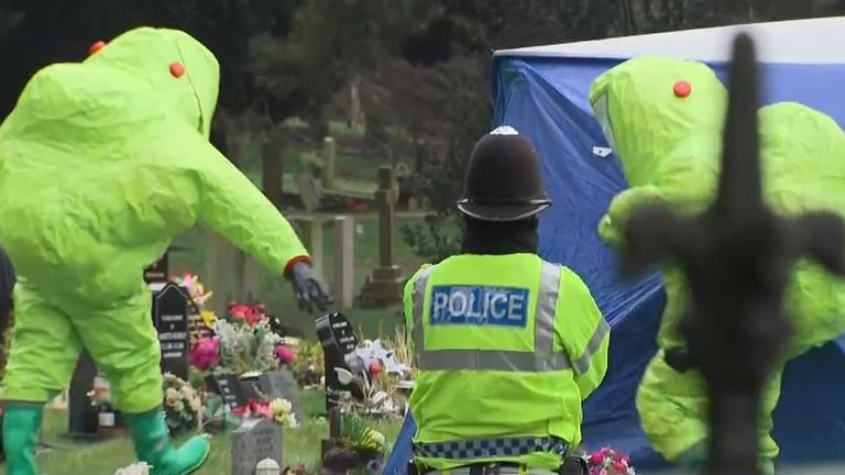 Police in forensic suits at a cemetery in Salisbury