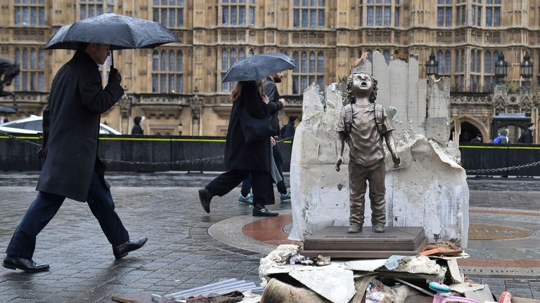 Save the Children placed a life-sized statue of a child outside parliament
