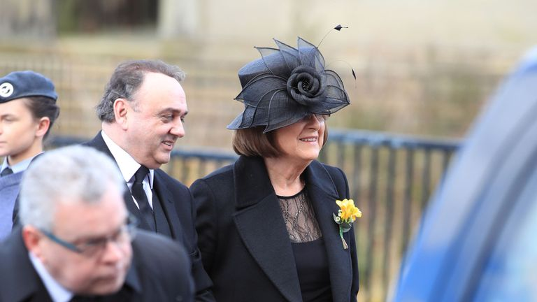 Sir Ken's wife Lady Anne and nephew John Lewis arrive ahead at the cathedral