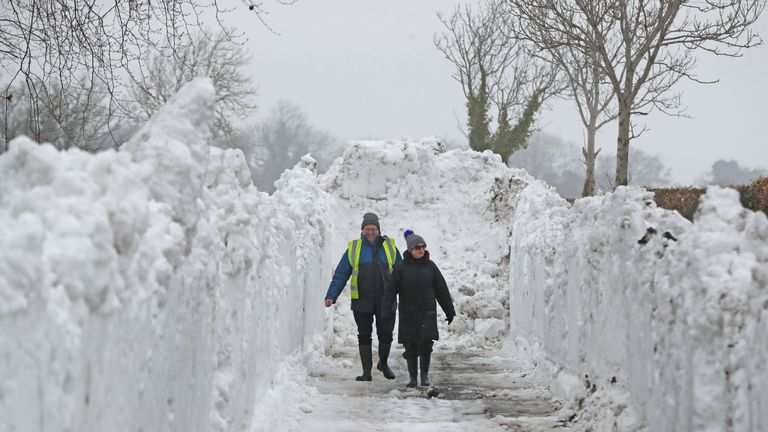Seamus Ashe and Maureen Sammon look at a trench of snow in Turnings, Straffan, County Kildare