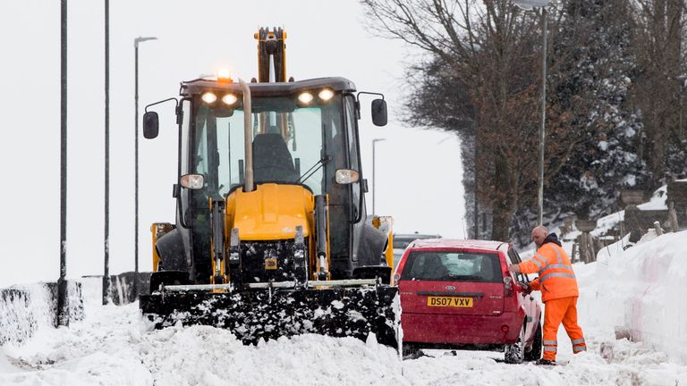 "A car gets stuck in snow in  Hayfield in Derbyshire as the wintry snap dubbed the ""mini beast from the east"" keeps its grip on the UK. PRESS ASSOCIATION Photo. Picture date: Sunday March 18, 2018. See PA story WEATHER Snow. Photo credit should read: Danny Lawson l/PA Wire"