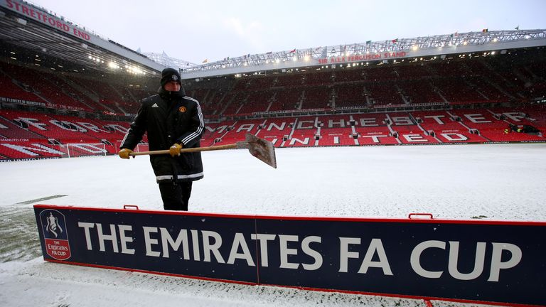MANCHESTER, ENGLAND - MARCH 17: Grounds staff clear the surrounds of a snow covered pitch at the Old Trafford stadium prior to the Emirates FA Cup Quarter Final between Manchester United and Brighton & Hove Albion at Old Trafford on March 17, 2018 in Manchester, England. (Photo by Alex Livesey/Getty Images)