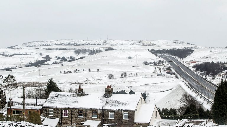 A farm house in the snow next to the M62 in Kirklees