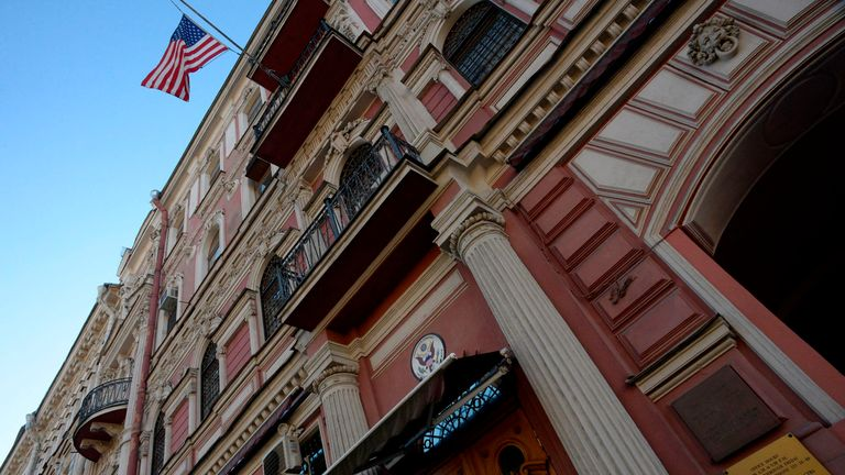 A Russian police officer stands guard outside the US Consulate in St Petersburg