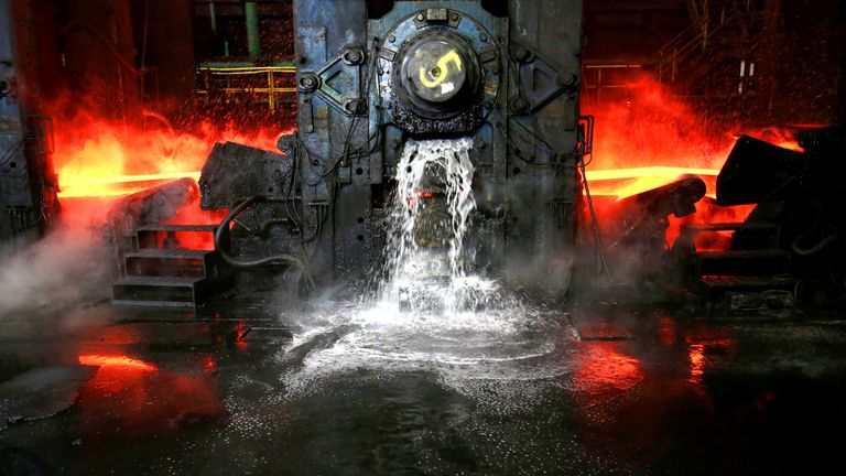 Water flows out as a steel slab is cooled at the Novolipetsk Steel PAO steel mill in Farrell, Pennsylvania, U.S