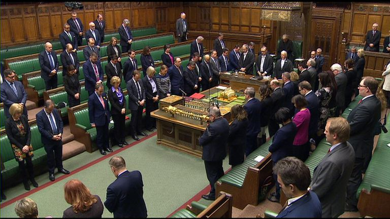 MPs bow their head for a minute's silence to mark the victims