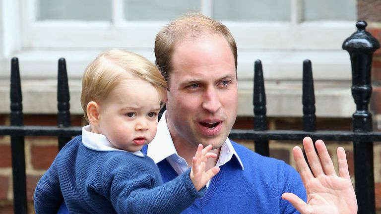Prince George with his father outside the Lindo Wing after the birth of Princess Charlotte