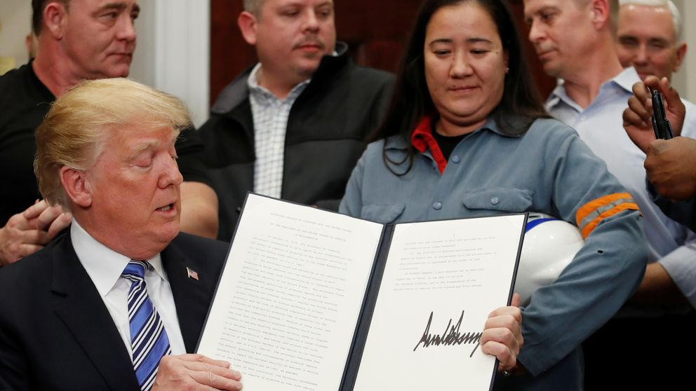 Donald Trump signs a presidential proclamation placing tariffs on aluminium and steel imports