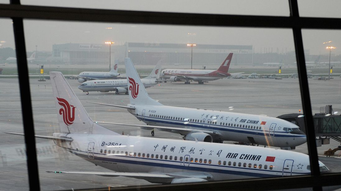 Aircrafts from Air China and Shanghai airlines wait to depart at the new International airport in Beijing on July 18, 2008