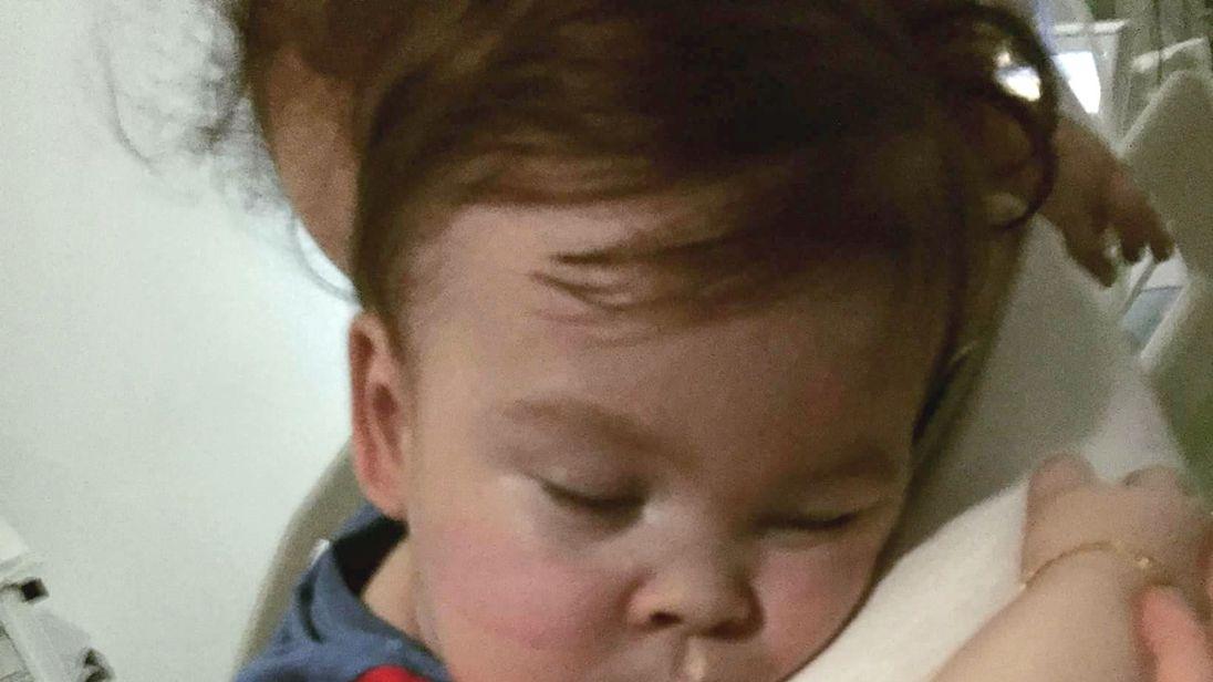 Alfie Evans cuddling his mother Kate James at Alder Hey Hospital