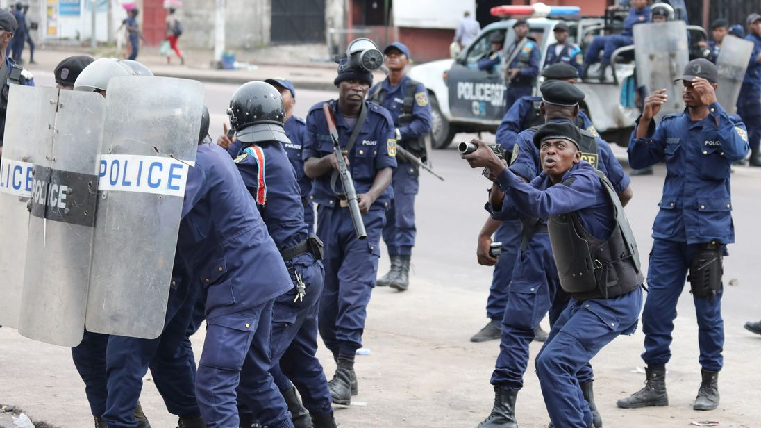 Police crack down on a protest in capital city Kinshasa