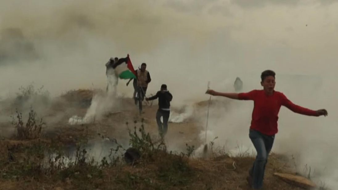 Palestinians protest along the Israeli-controlled Gaza strip.