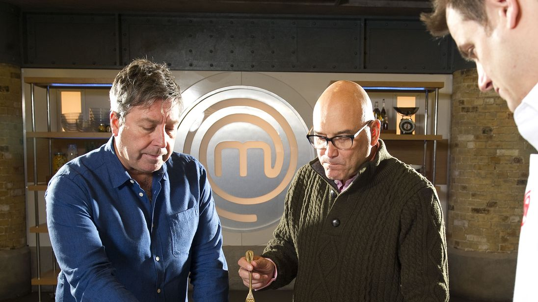 Writer Guy Adams (r) Takes Part In Masterchef in front of presenters and judges John Torode And Greg Wallace