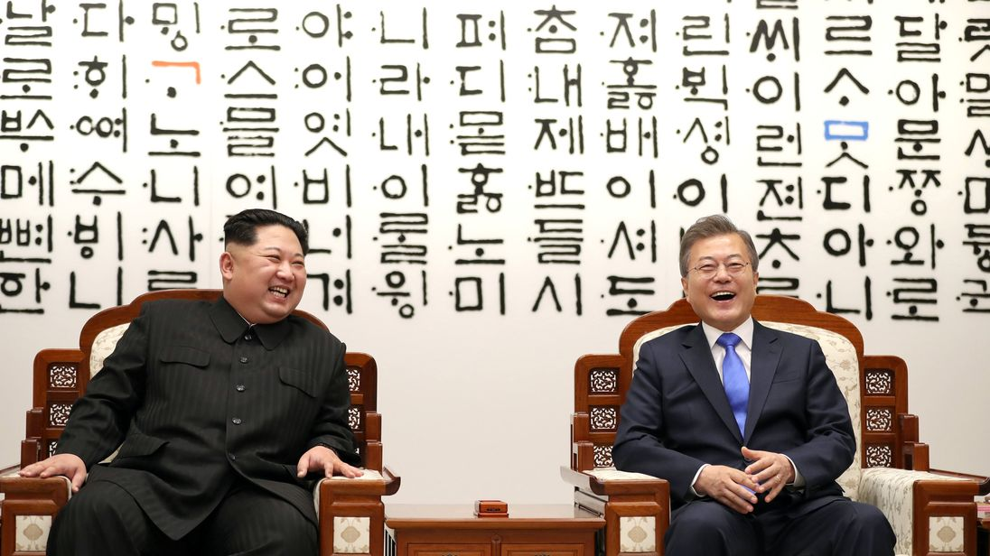 South Korean President Moon Jae-in talks with North Korean leader Kim Jong Un during their meeting at the Peace House