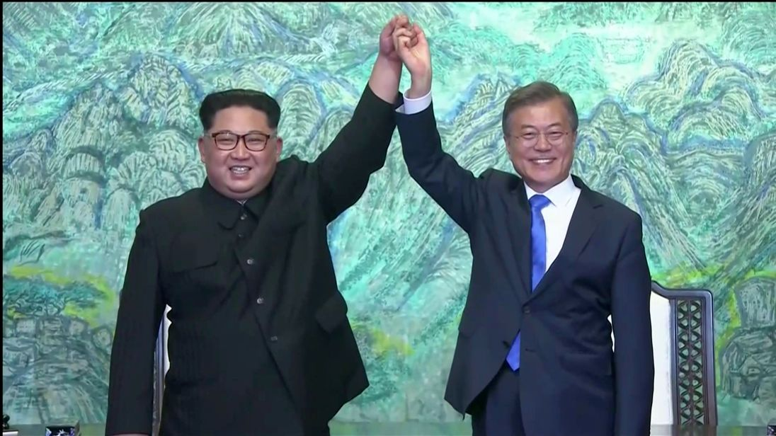 South Korean President Moon Jae-in and North Korean leader Kim Jong Un gesture after signing agreements