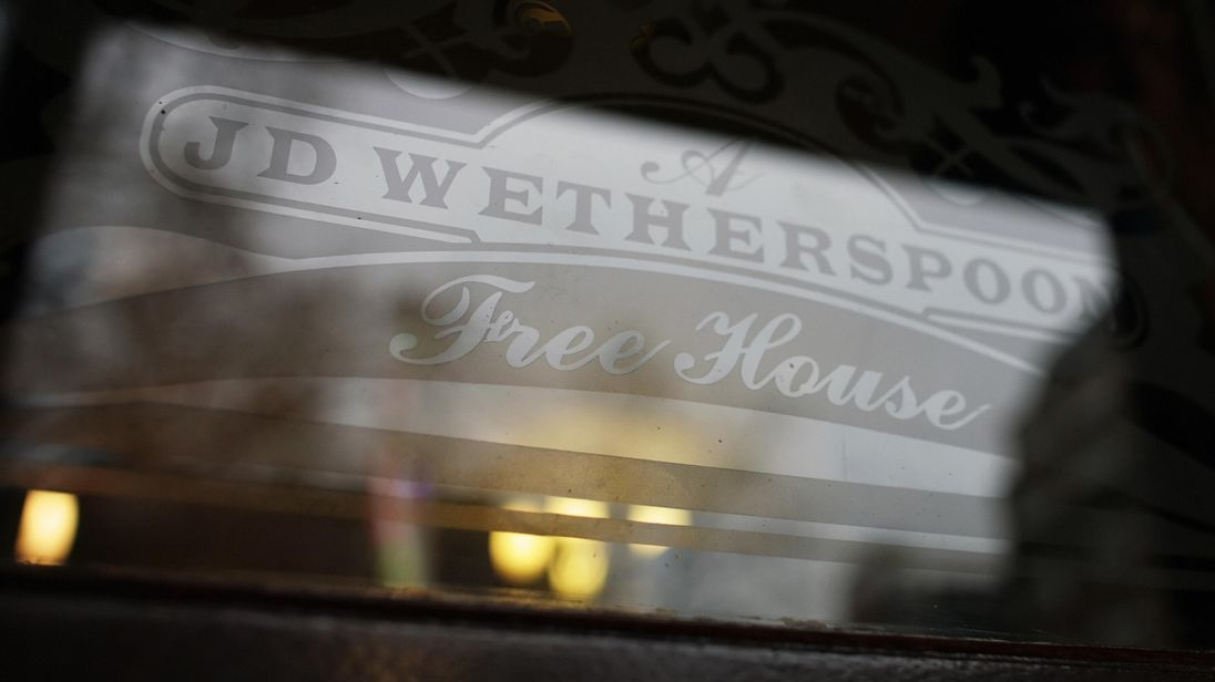 An etched window logo is shown after it was announced that adults with children are only allowed two alcoholic drinks at JD Wetherspoon pubs in order to limit their stay, 3rd January 2008. A spokesman for the company said it was 'uncomfortable' with children being on the premises for long periods because of a lack of play facilities. AFP PHOTO/LEON NEAL (Photo credit should read Leon Neal/AFP/Getty Images)