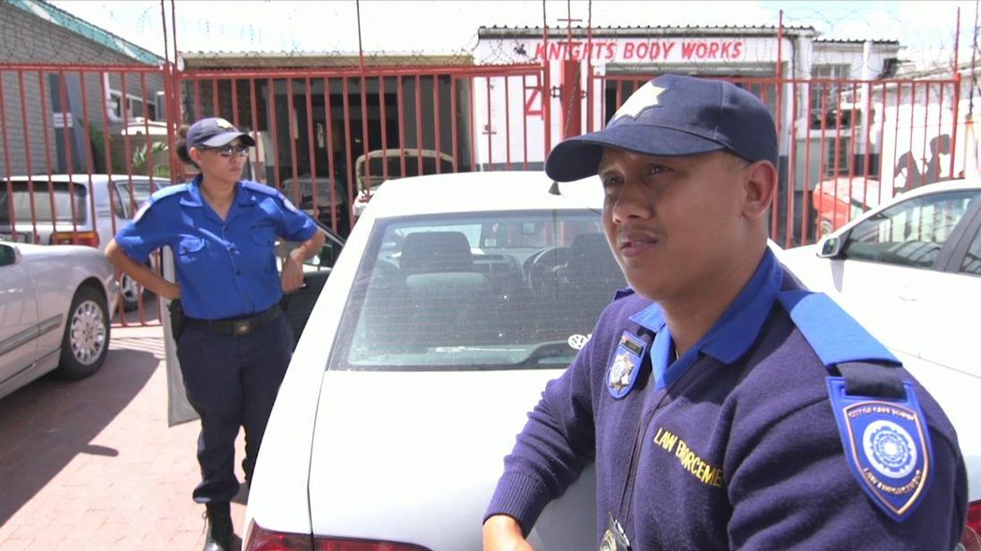 Officers Ashwyn Maxim and Natasha Terreblanche monitor water use in Cape Town