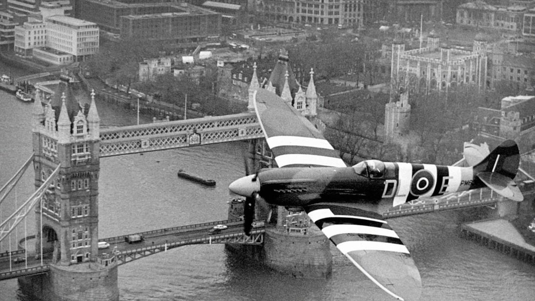File photo dated 01/11/06 of a Spitfire in Normandy invasion markings flying over Tower Bridge in London, as the RAF celebrates its centenary on Sunday
