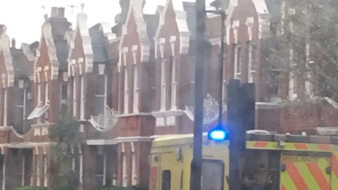 Scores of police officers were seen outside the house in Brixton, south London. Pic: Cristo Foufas