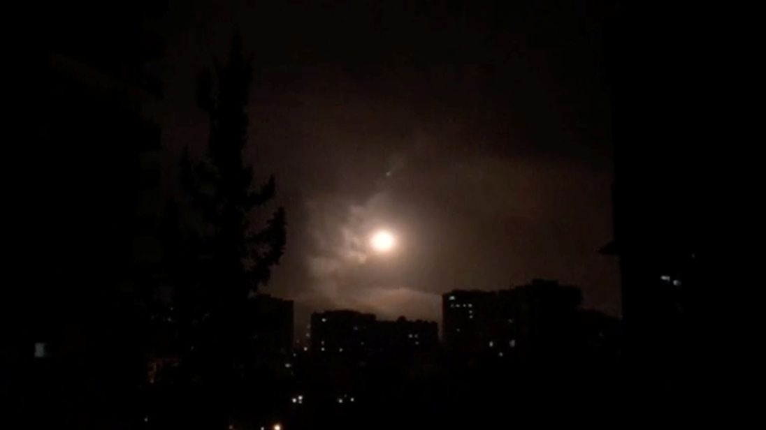 Syria air defences strike back after airstrikes by US, British and French forces in Damascus