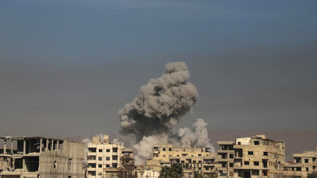 A general view shows smoke billowing in Hazeh, in the rebel enclave of Eastern Ghouta on the outskirts of Damascus on March 15 2018