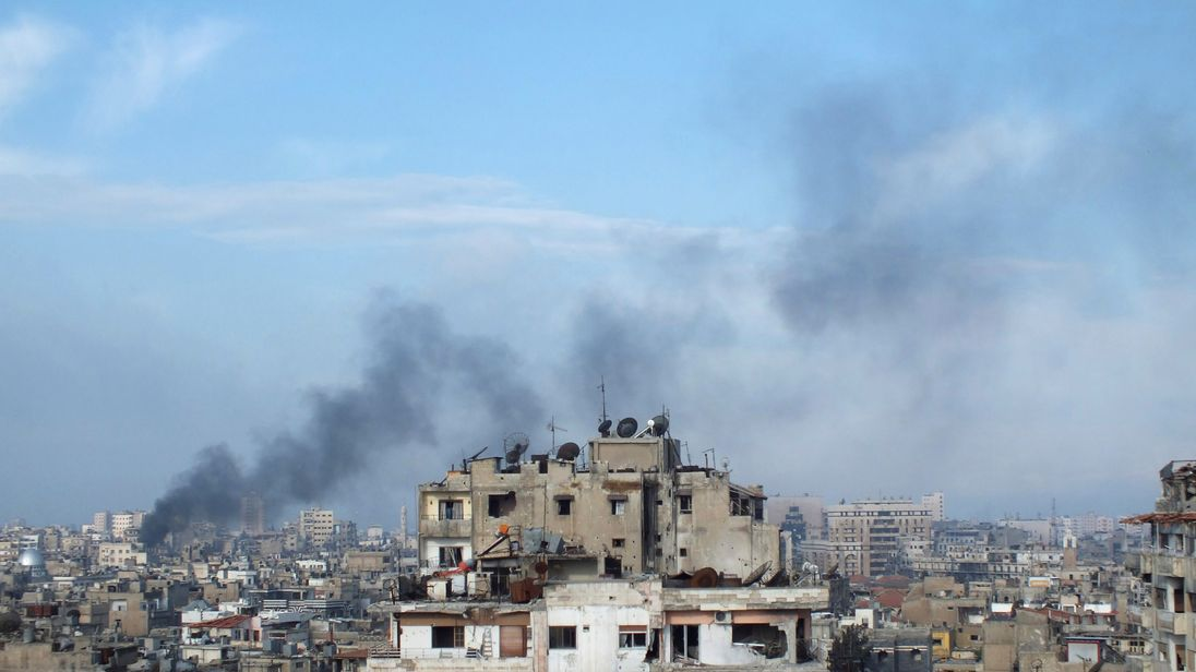 Smoke rises from one of the buildings in the city of Homs Syria
