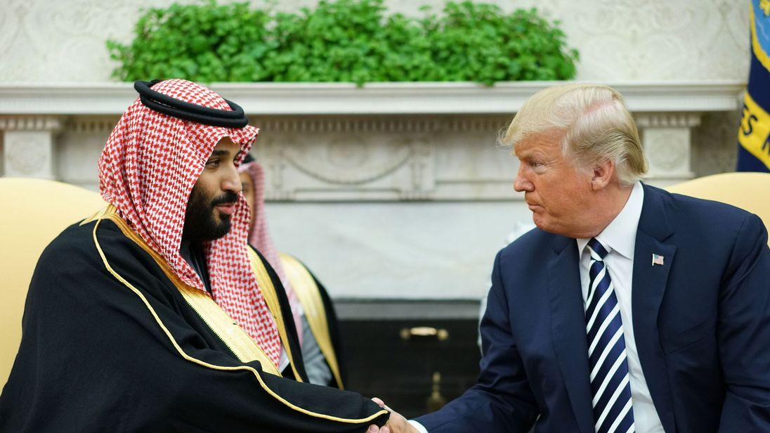 US President Donald Trump (R) shakes hands with Saudi Arabia's Crown Prince Mohammed bin Salman in the Oval Office of the White House on March 20, 2018 in Washington, DC